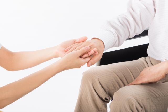 介護する手